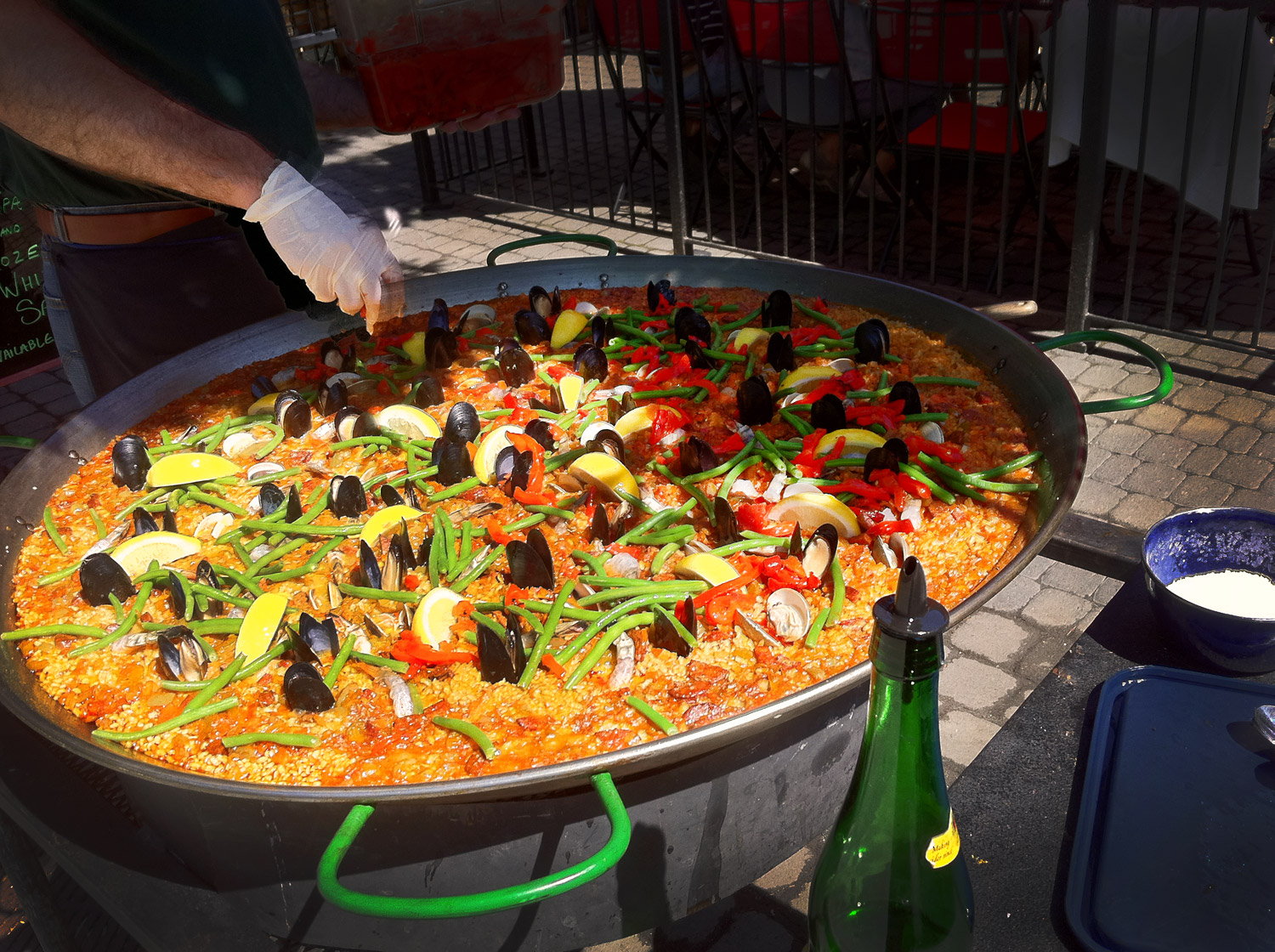 Paella being cooked on the sidewalk